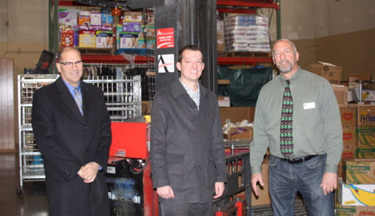 Associated donates forklift to Loaves and Fishes non-profit organization