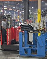Raymond Sideloader steel handling forklift in manufacturing plant